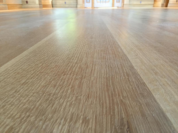 Final sanding pass on old hardwood floors in Maui